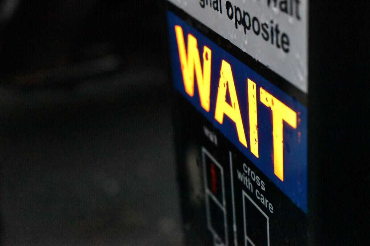 Crosswalk WAIT sign photo